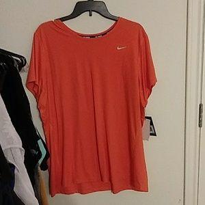 Orange Nike Dri-fit shirt